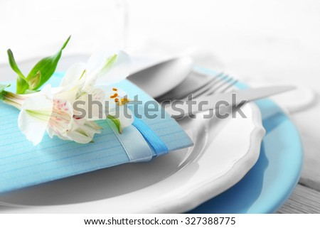 Table setting with flowers, close-up - stock photo