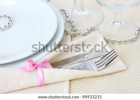 Table setting with fork, knife, plates, and napkin