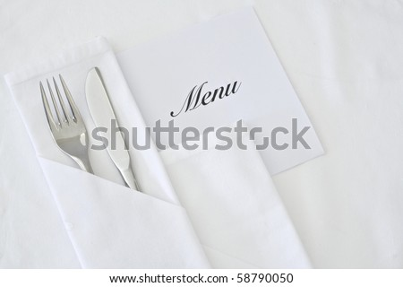 Table setting with menu - stock photo