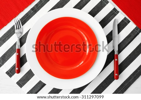 Table setting with red and striped napkins