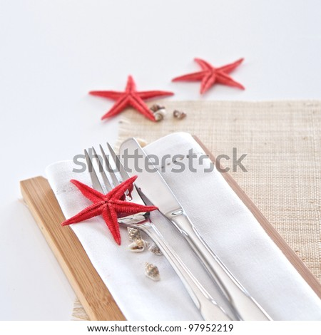 Table setting with seaside theme - stock photo
