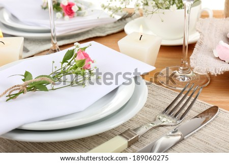 Table setting with spring flowers close up - stock photo