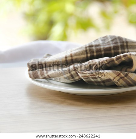 Table setting with vintage brown napkin, bright summer table decor.  - stock photo