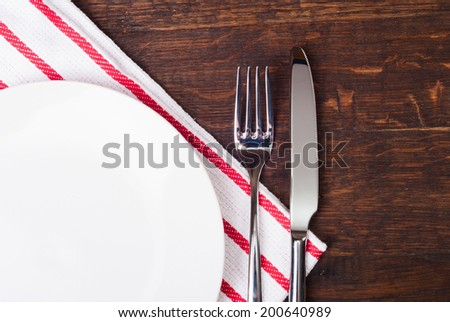 Table settings on wooden  background. - stock photo
