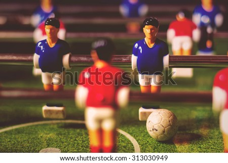 Table soccer game, vintage retro toned image, selective focus with shallow depth of field - stock photo