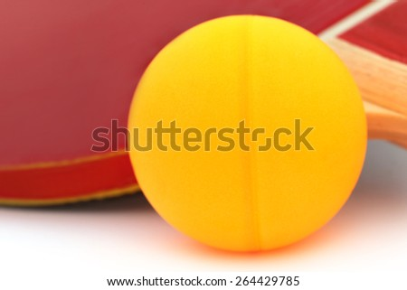 Table tennis ball with racket over white background - stock photo