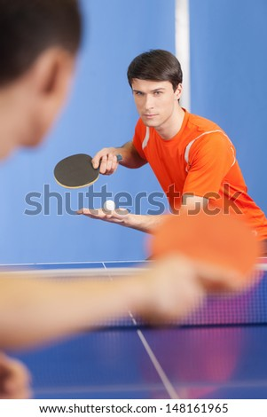 Table tennis game. Two young people playing table tennis