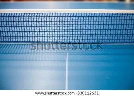 Table tennis net, blue spruce was spread. - stock photo