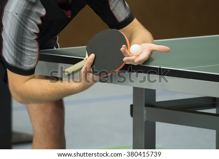 table tennis player serving - focus at the blade / small depth of focus