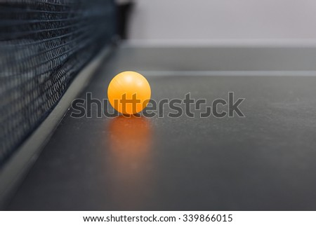 table tennis's ball on black table with net - stock photo