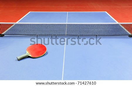 Table tennis table and racket - stock photo