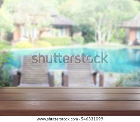 Table Top And Blur Swimming Pool Of The Background