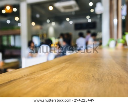 Table top Counter Bar with Blurred people in Restaurant cafe shop Background - stock photo
