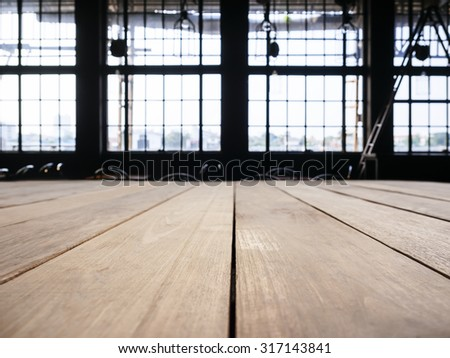 Table top counter bar with Interior Industrial Loft space background - stock photo