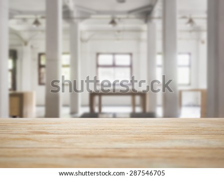 Table top counter bar with Interior Loft space background - stock photo