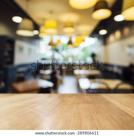 Table top counter with Blurred Bar Cafe light decoration background - stock photo