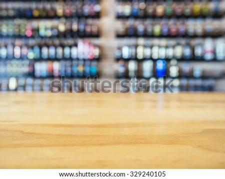 Table top Counter with Blurred Wine Liquor bottles Display Background - stock photo