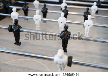 Table top football game with black and white figures. - stock photo