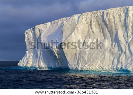 Table top icebergs float in Antarctic waters - stock photo
