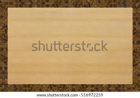 Table top of light wood, inlaid around the perimeter of the dark Karelian birch. Wooden background.