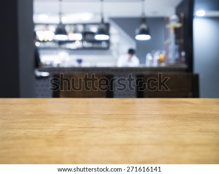 Table top with Blurred kitchen and chef on background - stock photo