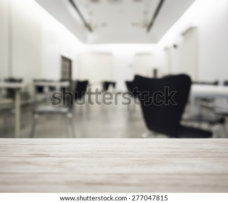 Table top with blurred office working space interior background - stock photo