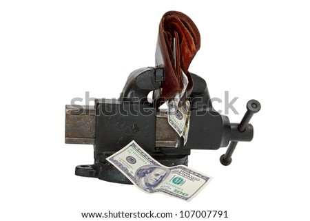 Table vise squeezing Dollars - stock photo