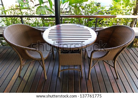 Table - wicker chairs. - stock photo