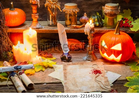 Table witches ready to write the scroll - stock photo