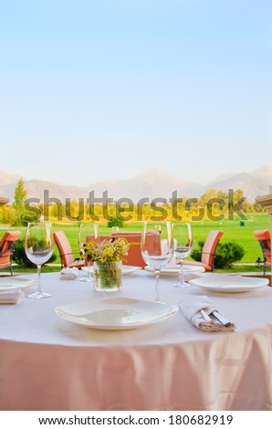 table with a view on mountains - stock photo