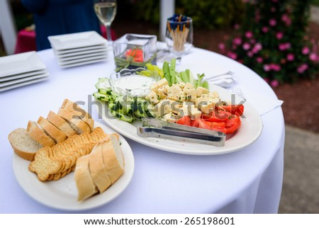 Table with appetizers - stock photo