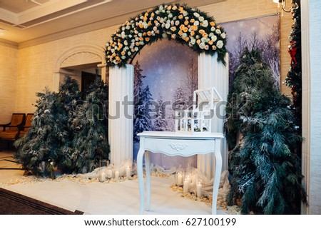 Table with chest stands before wedding altar made in winter style