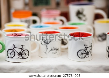 Table with colorful coffee cups - stock photo