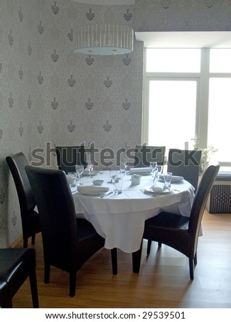 Table with cutlery, plates and glasses in Restaurant