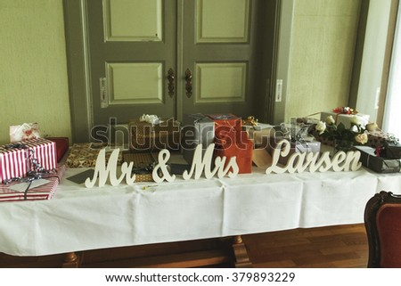 Table with decor and gifts for the wedding in the room