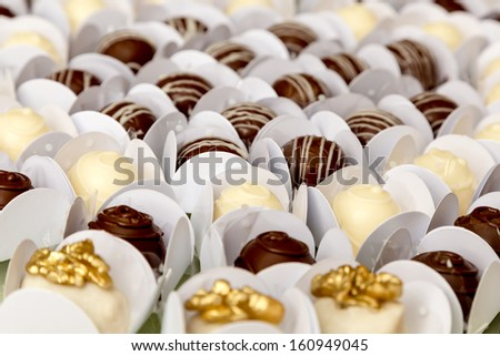 Table with delicious candies prepared for any special event - stock photo