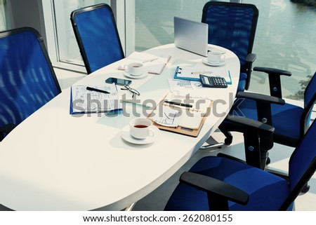 Table with documents after a business discussion - stock photo