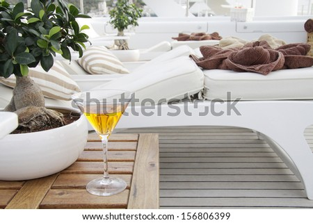 Table with drink on boat deck lounge zone