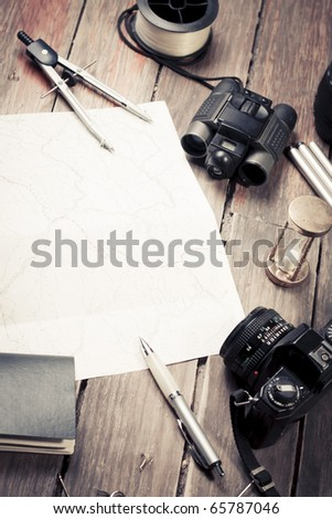 table with fishing and photography items - stock photo