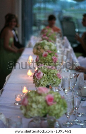 table with flowers at wedding reception