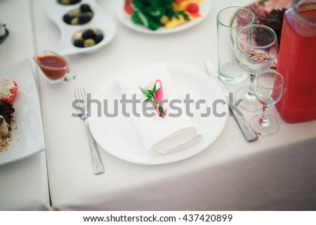 Table with food and drink - stock photo
