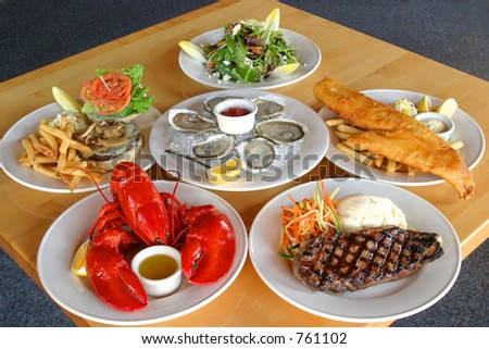 Table with food from a menu on it. - stock photo