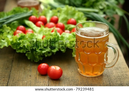 table with fresh vegetables and beer - stock photo