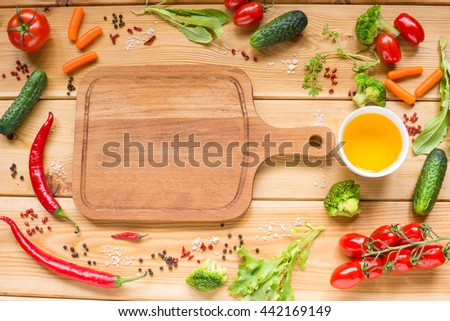 Table with fresh vegetables, tomato, pepper, cucumber, carrot, space for text on cutting board. - stock photo