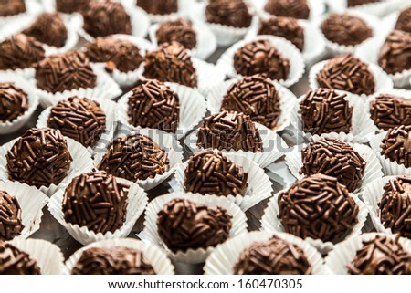 Table with Sweet Brigadeiro - It's typical in Brazil - stock photo