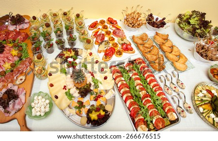 Table with tapas and mixed appetizers - stock photo