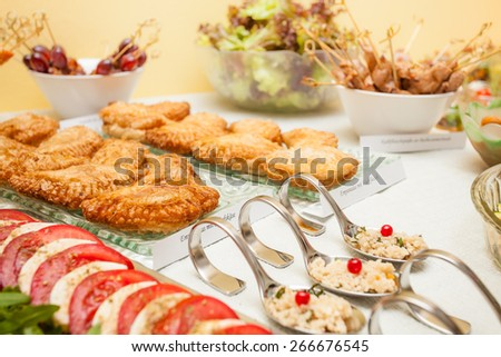 Table with tapas and mixed food - stock photo