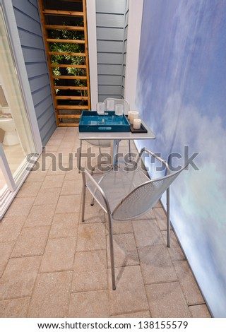 Table with the tray and the chair. Interior design. Vertical. - stock photo