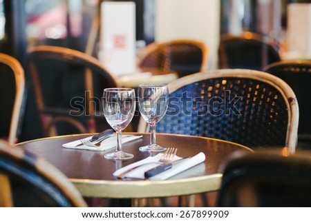 table with two goblets in restaurant - stock photo