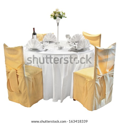 Table with utensils decorated with vases of flowers - stock photo